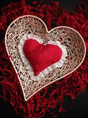 Red heart shape on shredded paper