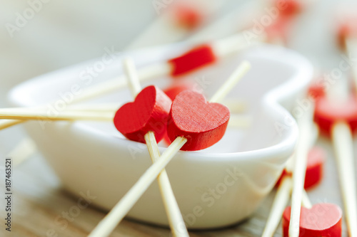 Valentines day concept. mini wooden red hearts on white Heart Cup