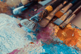Paintbrushes on colorful canvas - 187463778