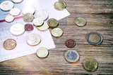 Euro banknotes and coins with bills to pay. Finances and budget