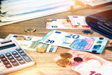 Euro banknotes and coins with bills to pay. Finances and budget background