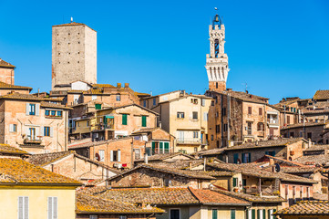 View of old centre town Siena in Tuscany, Italy.Rooftops of old city center of Siena, Italy.