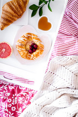 concept of breakfast in bed on tray with juice