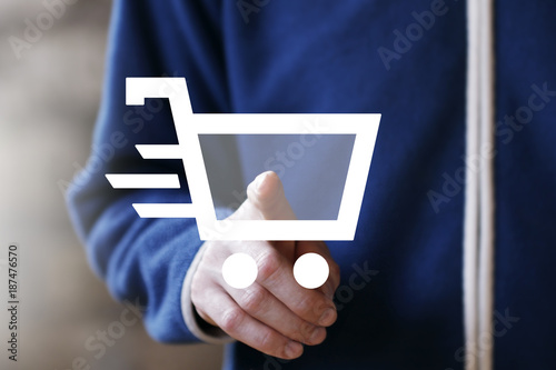 Businessman push button shopping cart icon