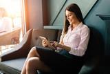 Portrait of successful businesswoman holding digital tablet - 187477346