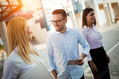 Foto op Canvas Snelle auto s Picture of young attractive business partners standing