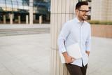 Businessman wearing glasses holding tablet