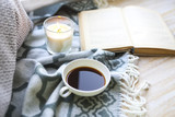 Cup of coffee, candle and book on the floor - 187485145