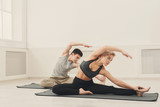 Fitness couple stretching at white background - 187491766