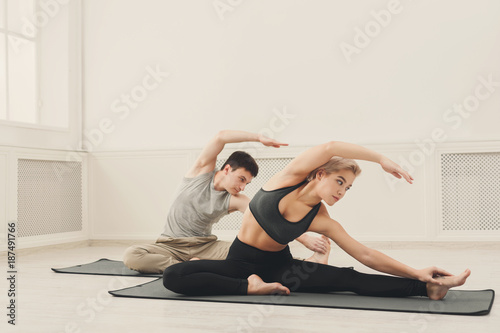 Fridge magnet Fitness couple stretching at white background