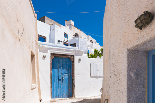 Santorini, Greece.  Pyrgos ls a famous village in Santorini island with cobbled streets, and White houses.