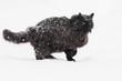 Un chat noir sous la neige - 187496521