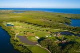 Aerial landscape photo of a coastal golf course - 187497377
