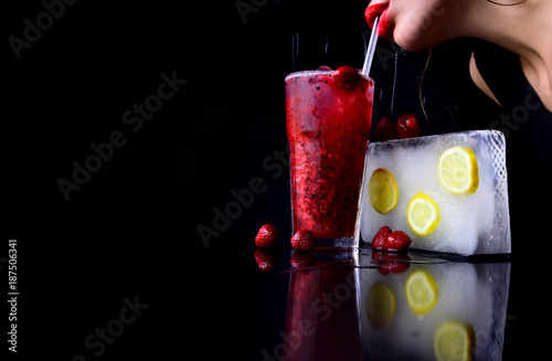 Cocktail with strawberry for young girl isolated on black. - 187506341