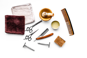Tools for haircut and shave. Razor, sciccors, brush on white background top view