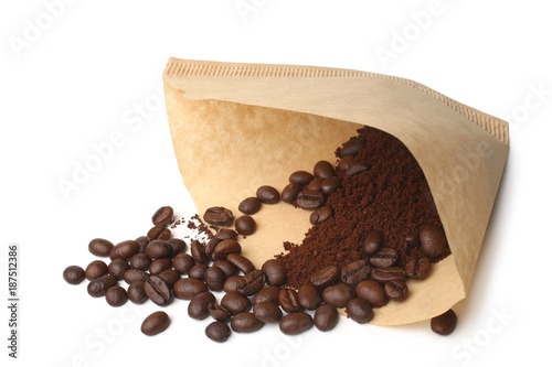 Foto Murales Filter with ground coffee and coffee beans