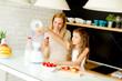 Mother and daughter preparing healthy juice - 187514325