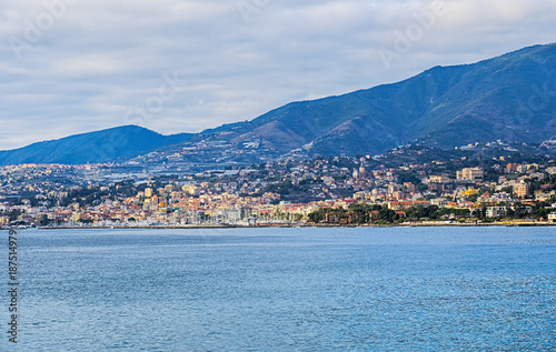 Fotobehang Liguria View of the Italian coast with the city of Sanremo in the background. This town is famous for the cultivation of flowers and the annual Italian song festival.