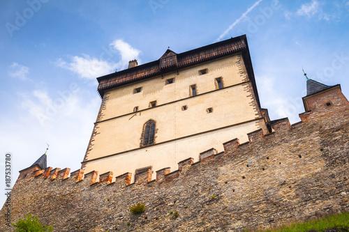 Karlstejn castle tower under blue sky Poster