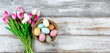 Bouquet of tulips and colorful eggs for Easter on white wood - 187536540