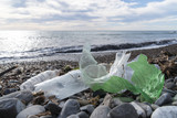 Marine pollution: plastic waste on the beach. - 187537794