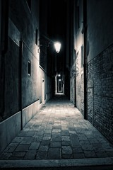 An empty alley somewhere in the city of Venice, Italy. © Jason Yoder