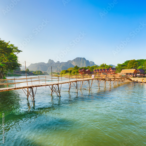 Foto op Aluminium Blauw Beautiful view of a bamboo bridge. Laos landscape.