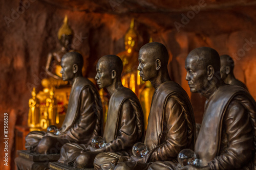 Aluminium Boeddha Buddhist monks statues symbol of peace and serenity at Wat Phu Tok temple, Thailand, ascetism and meditation, buddhist art work