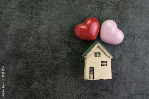 Valentine's day or romantic living family with love house with ceramic miniature house and red heart shape flat lay
