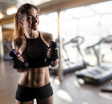 Determinated girl at the gym ready to start fitness lesson - 187562921