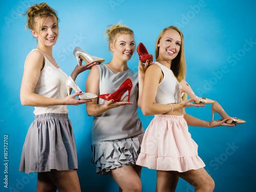 Foto Murales Three women showing high heels shoes