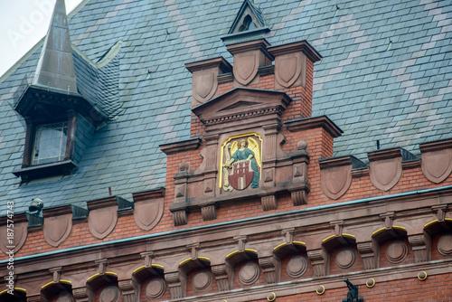 Fototapeta Torun (Poland), october 2017: Fragment of the neo-Renaissance edifice of the Artus House dates from 1891.