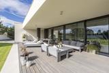 Grey garden furniture on board floor - 187575737