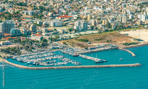 Staande foto Cyprus Sea port city of Larnaca, Cyprus. View from the aircraft to the coastline, beaches, seaport and the architecture of the city of Larnaca.
