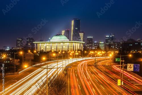 Fotobehang Nacht snelweg Light trails from vehicles on motorway at night seoul,korea
