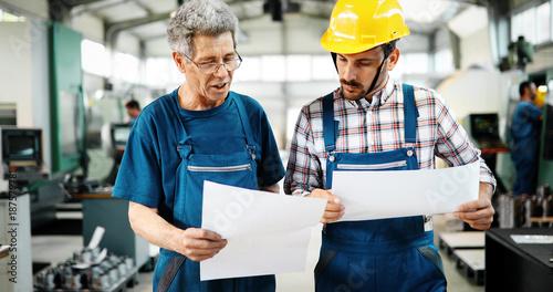 Foto op Aluminium Kasteel Factory worker discussing data with supervisor in metal factory