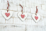 Three hearts of wood on wooden background - 187589535