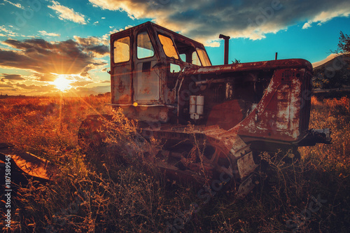 Fotobehang Trekker HDR image of old rusty tractor in a field. Sunset shot