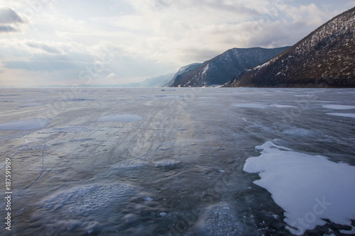 view of lake with ice surface and rocks formations on shore ,russia, lake baikal - 187591989
