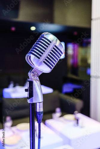 Retro microphone on stage in a pub - 187595135