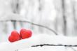 Red heart on snow background. St. Valentine's Day