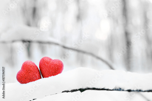 Red heart on snow background. St. Valentine's Day
