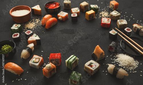Sushi and rolls background, frame on black - 187601137