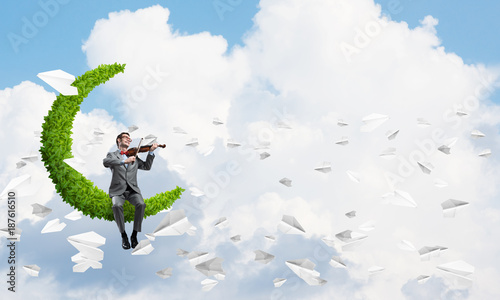 Foto Murales Handsome businessman play his melody and paper planes fly around