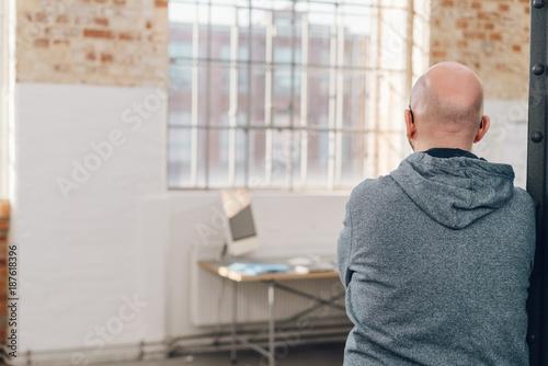Foto Murales Rear view of a man wearing gray hooded sweatshirt