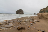 Marsden Rock from beach with pebbles - 187622188