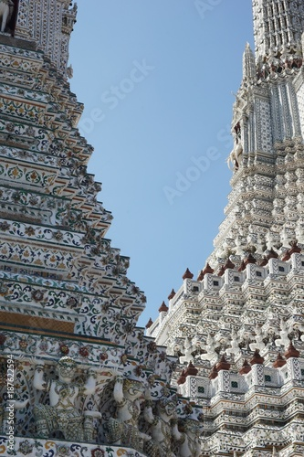Pra Prang Wat Arun in Bangkok, Thailand, decorated in coloured ceramic and stucco work sheated in coloured china.
