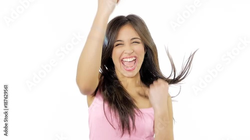 Cute hispanic woman jumping from happiness thumb up isolated slow motion