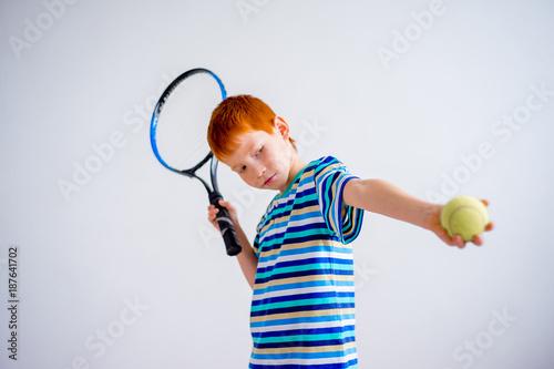 Fototapeta Boy playing tennis