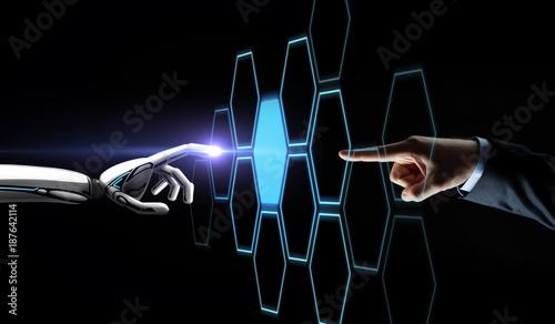 Foto Murales robot and human hand touching network hologram